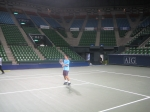 Kei practices on court for the AIG Open
